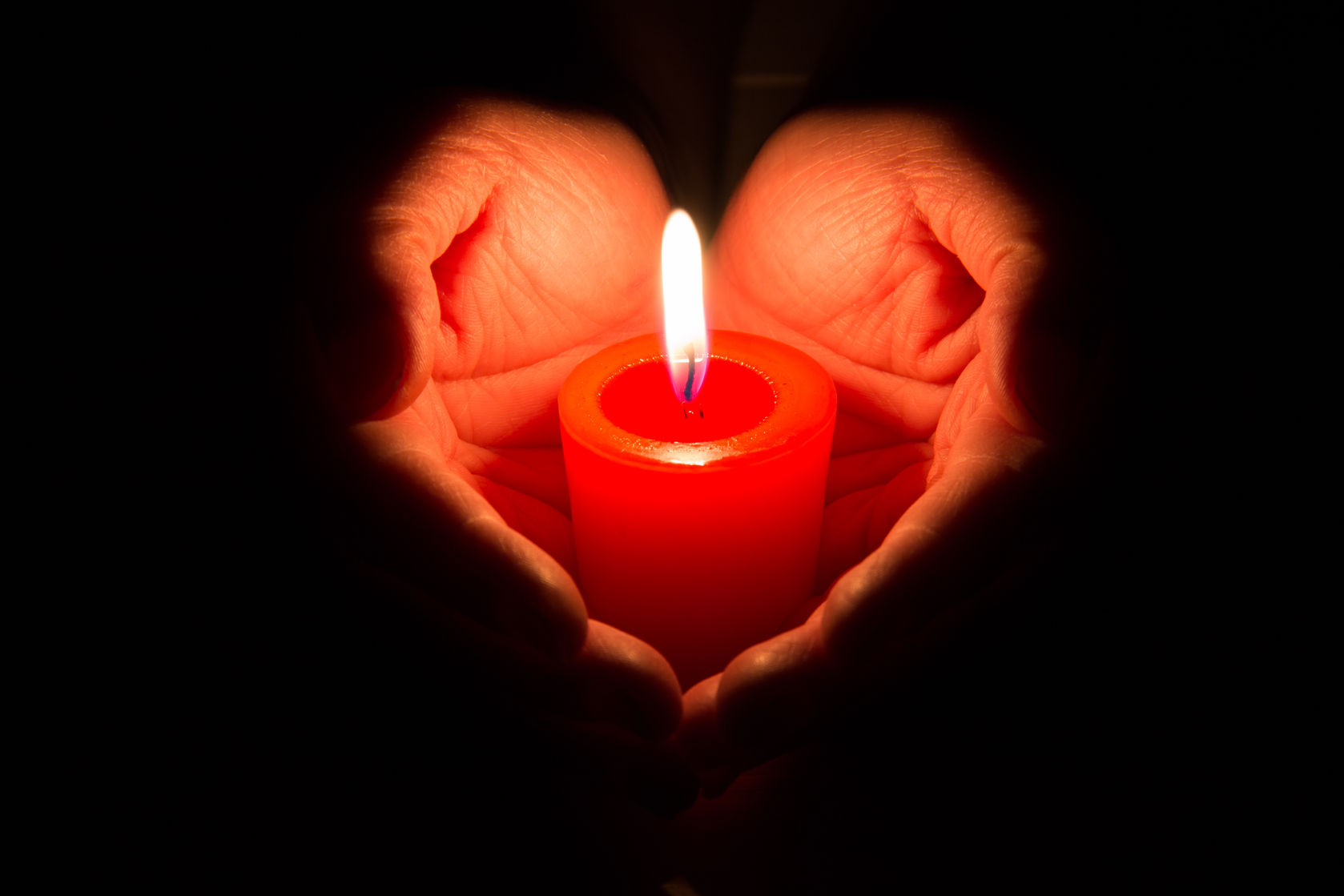 Heart Hands Holding a Candle.jpg